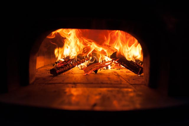 All of the baking at the conference was done in wood-fired ovens, which needed to be kept warm all night for the next days bake.