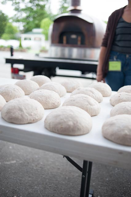 Barak Olins has shaped his rye dough that will be baked in the copper wood oven.