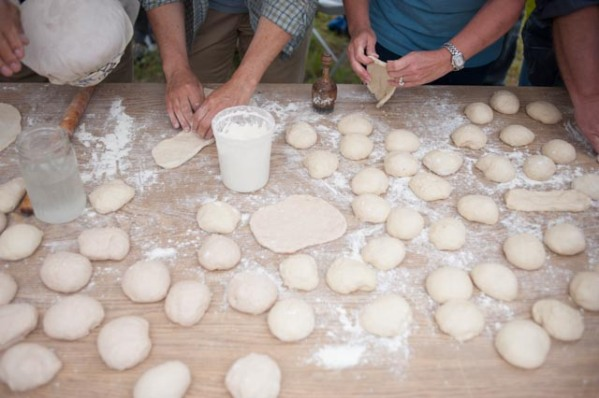 Stretching the dough before baking it in the Tandoor.